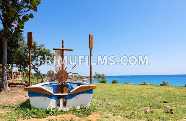 Photo of a sailor boat on a beach in protaras, Cyprus island - frimufilms.com