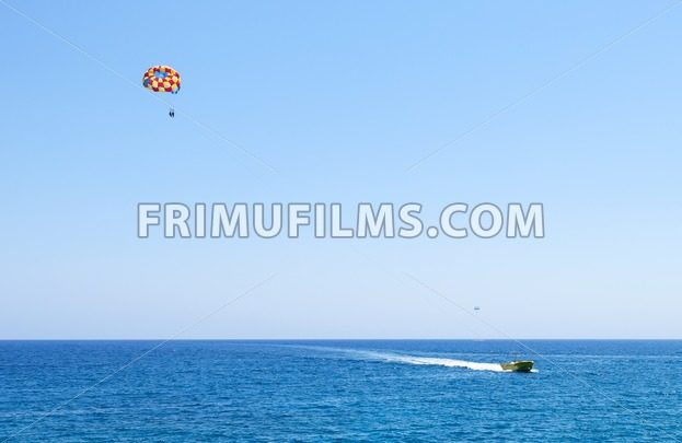 Photo of sea in protaras, cyprus island with parasailing and a boat - frimufilms.com