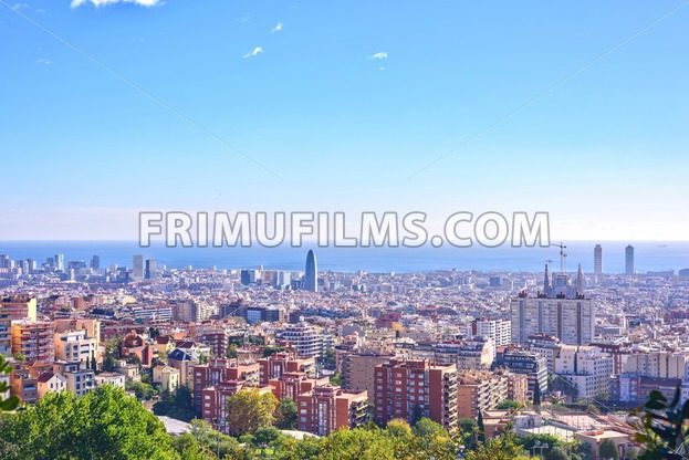 Barcelona city View from Park Guell at sunrise. Beautiful blue sky - frimufilms.com