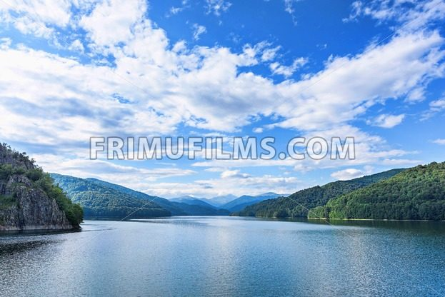 Photo of vidraru lake in fagaras mountains - frimufilms.com